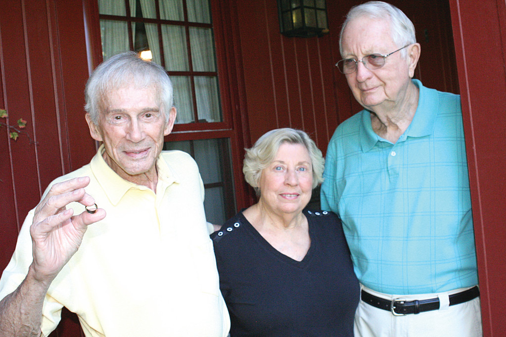 BACK TO RETRIEVE SOMETHING: Jerry Goldstein, left, with Richard and Svea Berggren who bought his house in Governor Francis Farms in 1998. While doing yard work recently, Richard found Joan Goldstein's wedding ring.