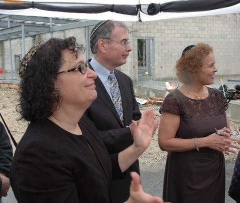 STEP TO A NEW HOME: Rabbi Amy Levin, Andrew Sholes, chairman of the Torat Yisrael Building Committee, and Susan Smoller, president of Temple Torat Yisrael, at the congregation's cornerstone dedication Sept. 30 in East Greenwich.