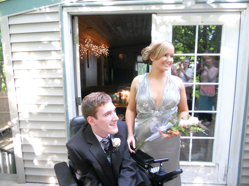 RITE OF PASSAGE: Stephen Carroll, a 2012 graduate of Johnston High School, thought he would miss out on prom until a stranger, 16-year-old Taylor Boardman-Kelly, volunteered to be his date.