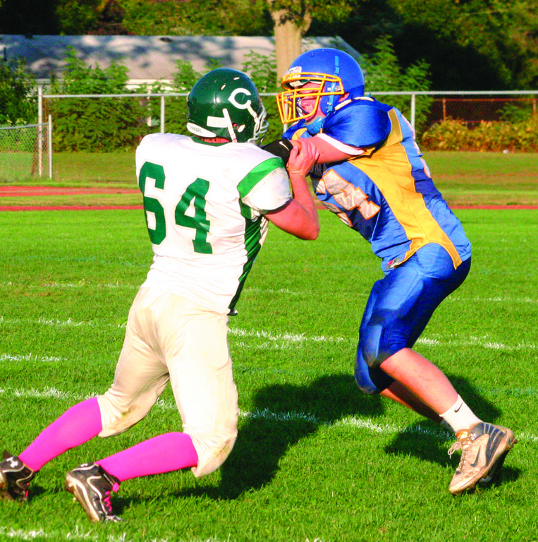 ONE ON ONE: Vets' John McNally tries to get around a Chariho blocker in Friday's game.