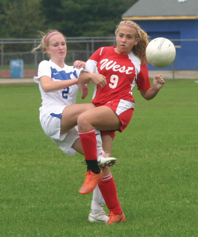 TANGLED: Vets' Katelyn Ravenell battles Cranston West's Haley Nardolillo for the ball in Thursday's game.