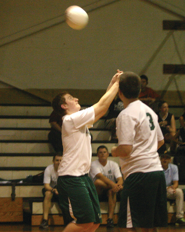 Hendricken's Aaron DeMarco hits the ball back over the net.