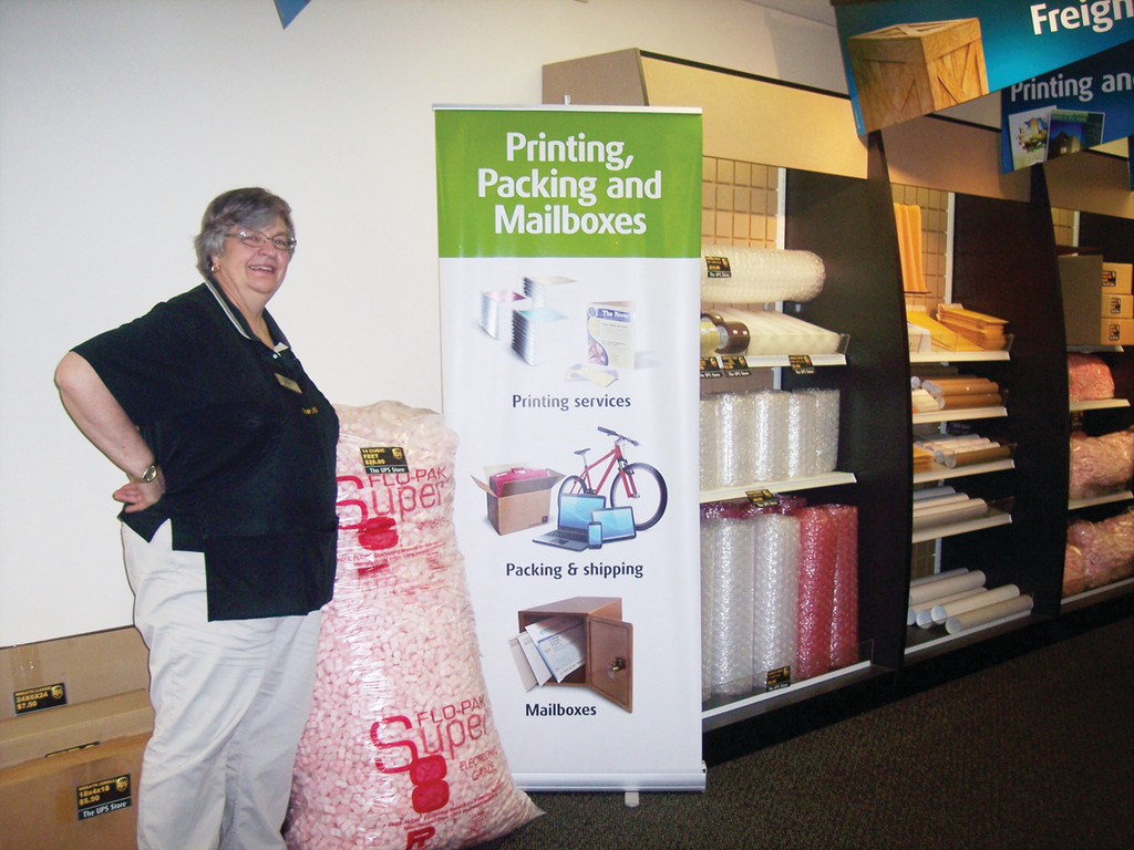 Owner Eileen showcases some of the many packing supplies available at this convenient UPS Store in Warwick.