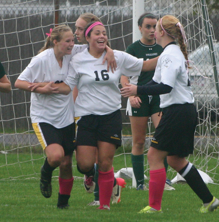 ROLLING ON: Haley McCusker celebrates her first goal in Tuesday's 3-0 win over Ponaganset.