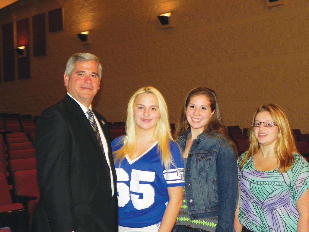 SAY NO TO TEXTING: Attorney General Peter F. Kilmartin was at Toll Gate High School on Friday, spreading the word about the dangers of texting and driving and reminding teenagers that it is illegal. Pictured with Kilmartin are Jordan Ethier, Mikayla Rogers and Julie Penn, the class president, vice president and secretary of the 11th grade.