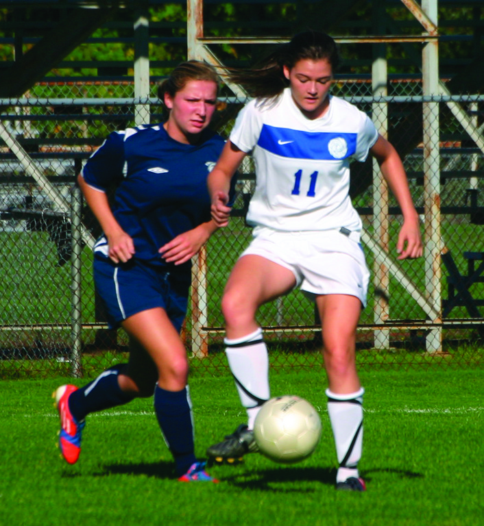 PROTECT: Toll Gate's Jordan Inkley and Vets' Sloan Kinney battle for possession on Thursday.