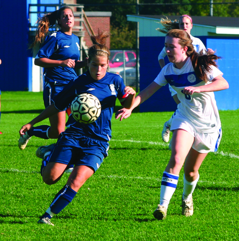 KICK IT UP: Toll Gate's Emily Fox tries to get past Vets' Kara McCrudden in Thursday's game. The Titans won 4-1 to improve to 4-6 on the year.
