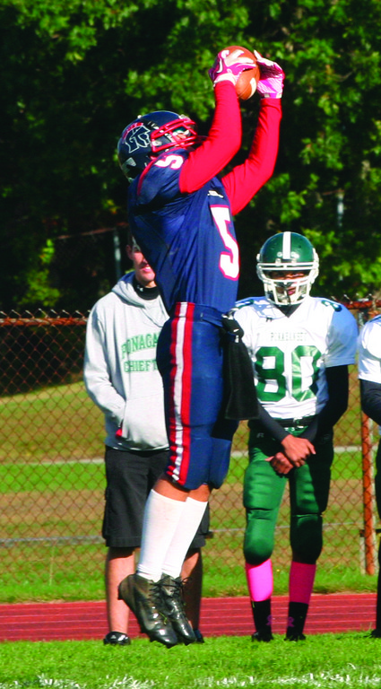 RISING: Toll Gate's Malique Woods makes a leaping catch in Friday's game against Ponaganset.