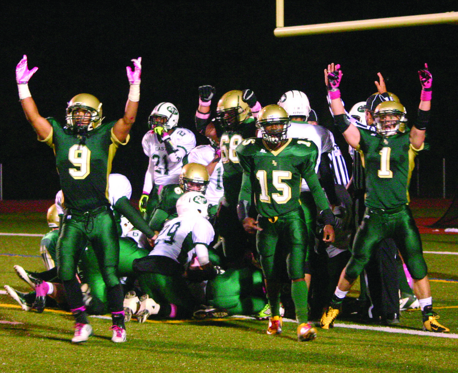 HANDS UP: Hendricken's Jarrid Witherspoon (9) and Marco DelVecchio (1) celebrate the go-ahead touchdown in Hendricken's 21-14 win over Cranston East.
