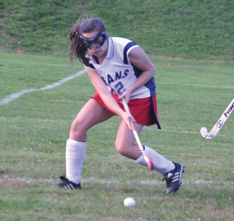REACHING: Lindsey Hopkins tries to get control of the ball in Friday's game against Cranston East.