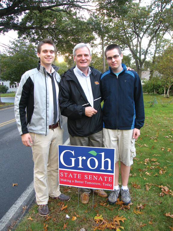"ON THE TRAIL: Arthur ""Jack"" Groh (center) stands with his sons, John, 20, at left, and James, 16. Groh's sons have been helping him put up campaign signs and knock on doors throughout the district."