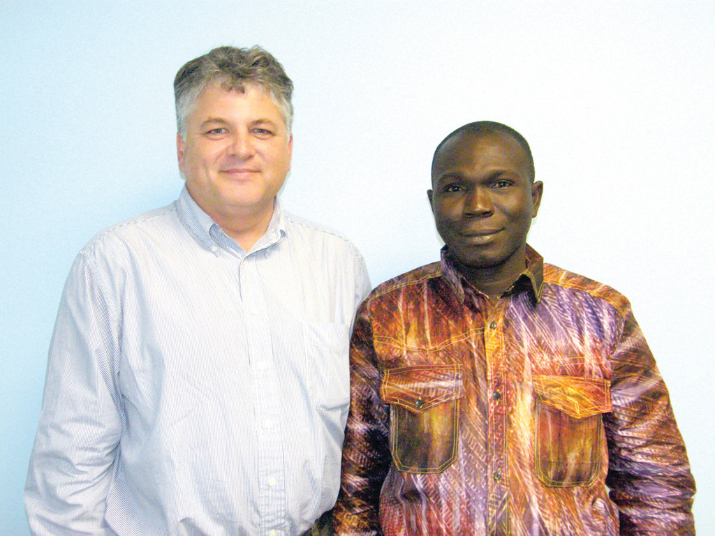 FAR FROM HOME: Topher Hamblet (left), the founder and president of The Foundation for West Africa, stands with Hassan Koroma, a radio station manager from Sierra Leone. Koroma will speak about his experiences in the post-war Sierra Leone on Saturday at the Warwick Public Library.