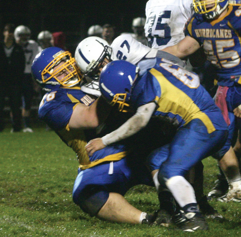 PULLING HIM BACK: Vets' Oliver Sylvestre (left) and George Schmeider stuff a Westerly run in Friday's game.