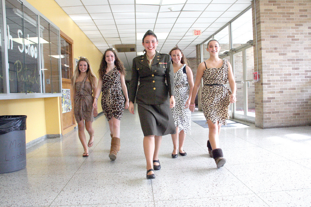 "DECADES DAY: Tuesday was ""decades day,"" and Casey Adams wore the uniform of her late aunt Rita Rominski, who served as a nurse in World War II. The cave girls from left are: Megan Wilks, Emily Degnan, Maddie Tyrell and Lauren Wade."