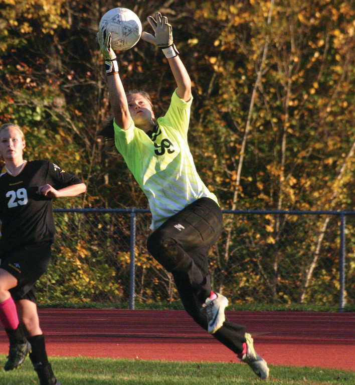 CATCHING ON: Pilgrim's Hannah Page makes a leaping save in Monday's game against Exeter/West Greenwich. With a 2-2 draw, Pilgrim became the first team to take a point from EWG since 2010.