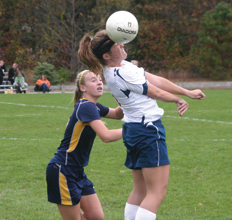 UP HIGH: Emily Waggonner leaps to head the ball.
