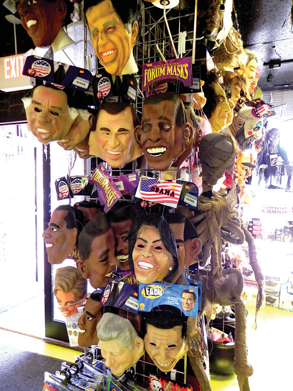 ALMOST AS FRIGHTENING as the election itself is the column of presidential masks on display at Rhode Island Costume. Obama, Romney, both Clintons and good old Richard Nixon are available.