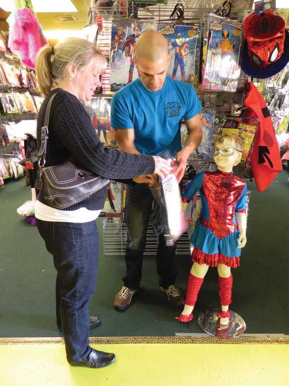 FRANK MATARESE has been working at Rhode Island Costume for 11 years and continues to offer advice on costumes. Wendy Moran of Cumberland asked him about a scarecrow outfit for herself. The little girl beside Matarese is actually a mannequin in a Spider Girl outfit.
