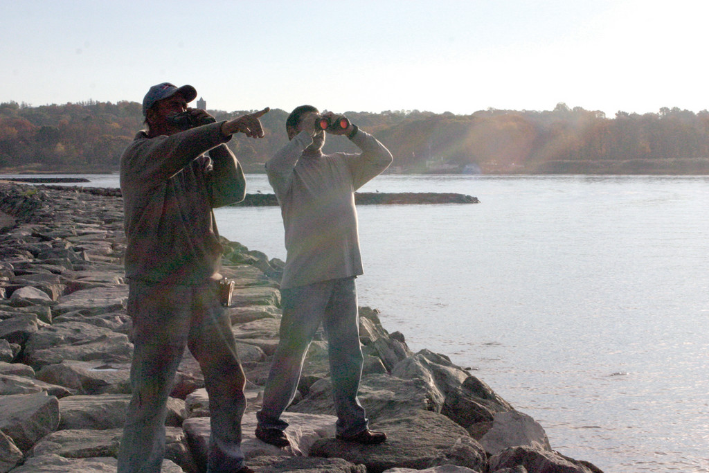 ON THE LOOK OUT: Emanuel Simas and George Clesos, the custodian for JONAH, search the water for debris. Neither of them saw any plane remnants.