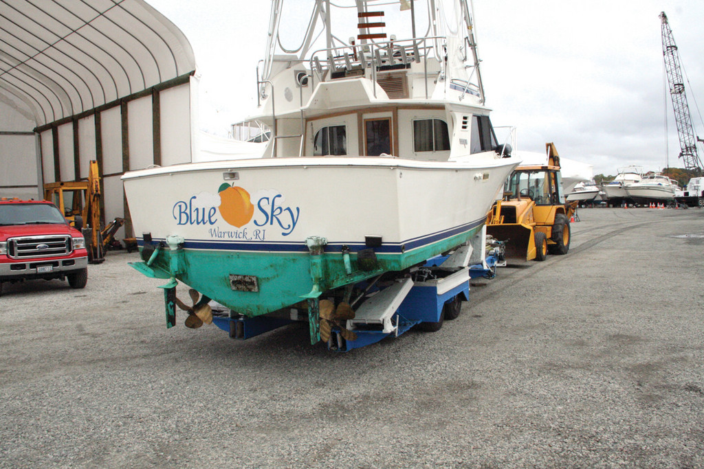 WHAT BLUE SKY? The staff at Pleasure Marina on Warwick Cove started hauling boats Friday and kept the pace through Sunday as the winds sweeping in Hurricane Sandy picked up.