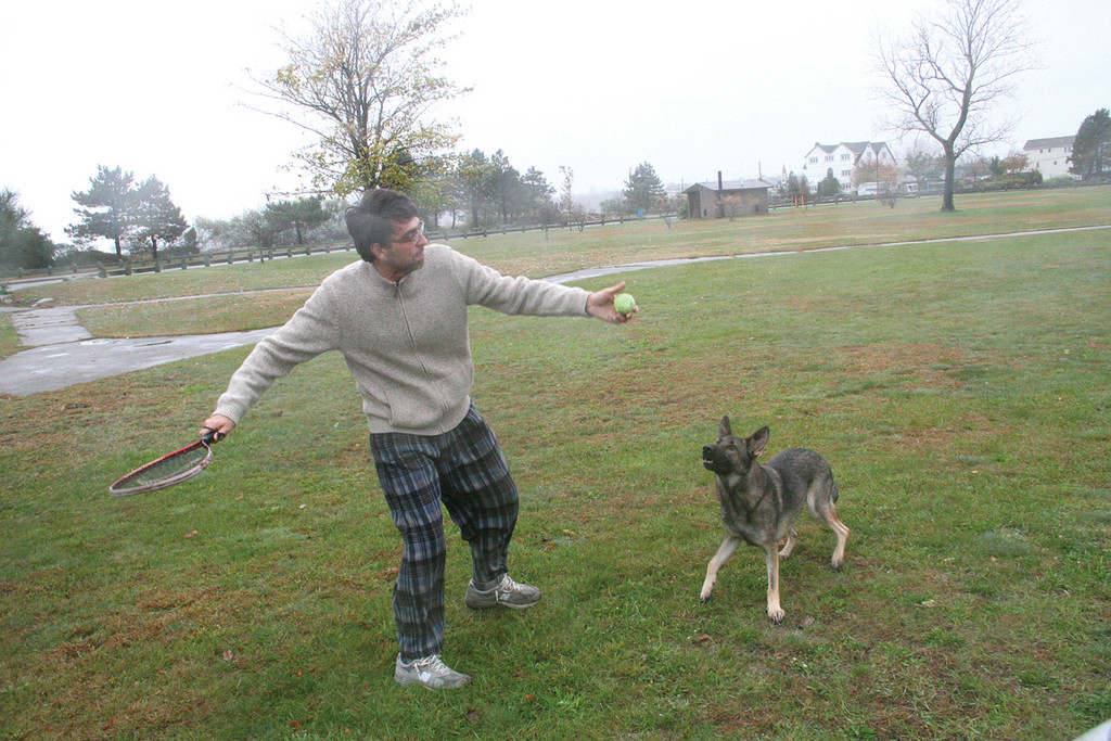 REALLY TAKING OFF: The wind added an extra boost to the flying tennis ball Monday morning as Paul DiChicco exercised his dog Max at Conimicut Point before retreating indoors to wait out the storm.