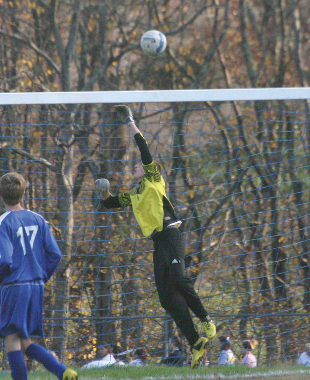 Mike Riccitelli leaps for a shot that sails over the crossbar.
