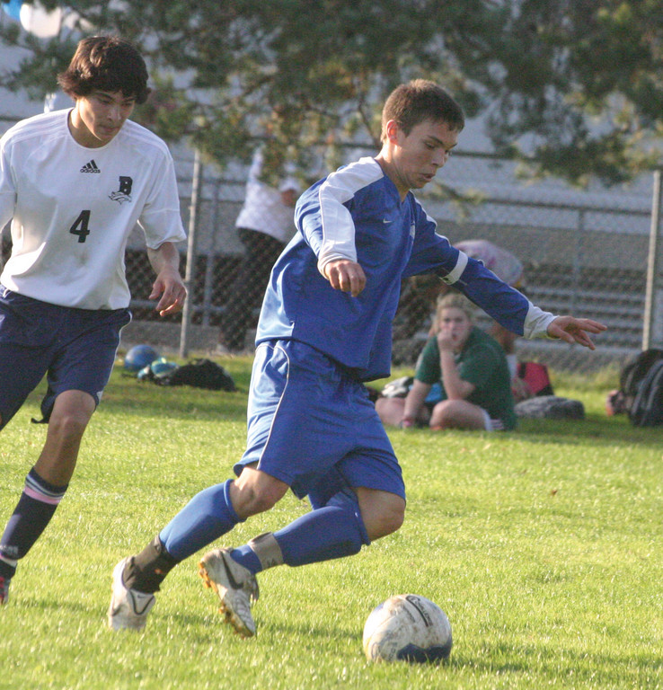 COMING THROUGH: Will Hay tries to maneuver his way around a Burrillville player on Friday afternoon.