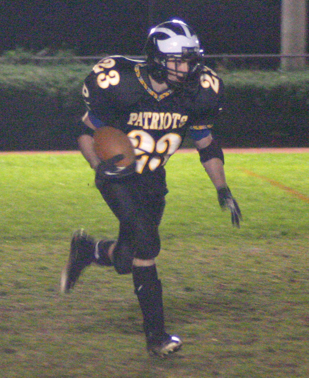 MOVING: Pilgrim's Mike Kelly returns a kick on Friday. Kelly rushed for 101 yards in the loss to Rogers.