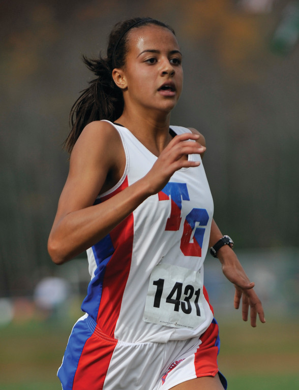 LEADING THE CHARGE: Toll Gate's Erika Pena heads for the finish line in last week's Class B Meet.