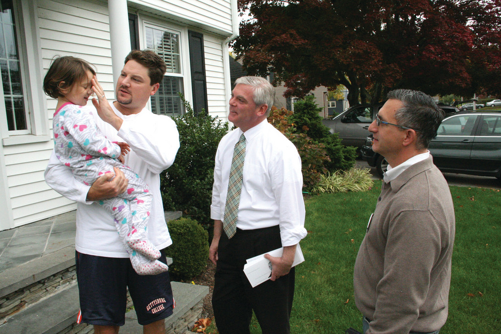 TOO YOUNG TO VOTE: Mayor Scott Avedisian talks with Peter Carney and gets to meet his daughter, Rowan, while canvassing Gaspee Plateau with Ward 1 Councilman Steve Colantuono Sunday.