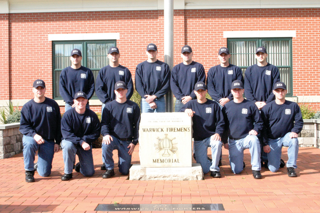 PRIDE FOR WARWICK: The class poses outside the WFD by the Firefighter Memorial.