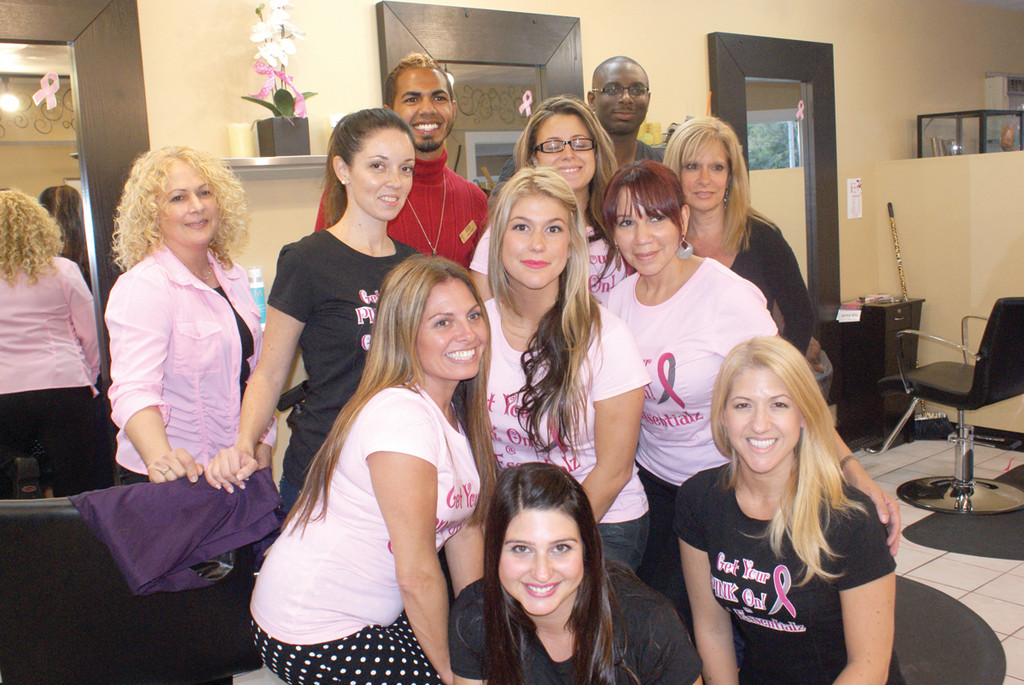 TEAM ESSENTIALZ: The staff at Gel Essentialz held a pink out for beauty to recognize October as breast cancer awareness month and to raise funds for the Gloria Gemma Breast Cancer Resource Foundation.