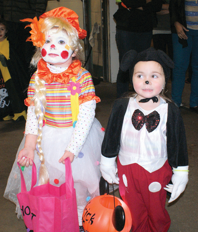 MAKING NEW FRIENDS: The annual Halloween Party, sponsored by the Cranston Fire Department and the city of Cranston, was held Halloween night for the community. Pictured are new friends 4-year-old Arianna Fournier as the Blonde Clown with 3-year-old Hailey Dunning as Mickey Mouse.