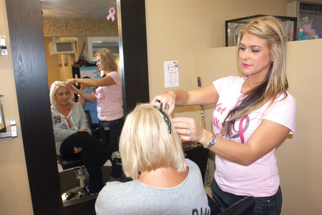 A TOUCH UP OF PINK: Cranston resident Gail Santosuosso relaxes as she gets her hair done by her daughter and employee at Gel Essentialz, Lauren Santosuosso.