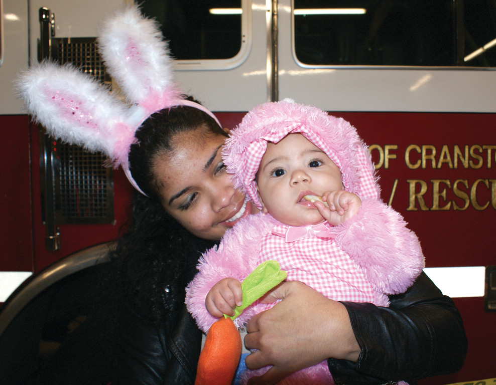 PINK BUNNY: Dahiana Rodriguez dressed up her 7-month-old Darleny as a pink bunny at the Cranston Fire Station # 2 on Pontiac Ave.