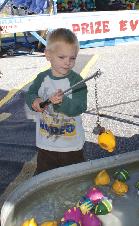 SOMETHING FISHY: Kyle Barlow, age 4 of Cranston, makes his big catch during the first Cranston Octoberfest.