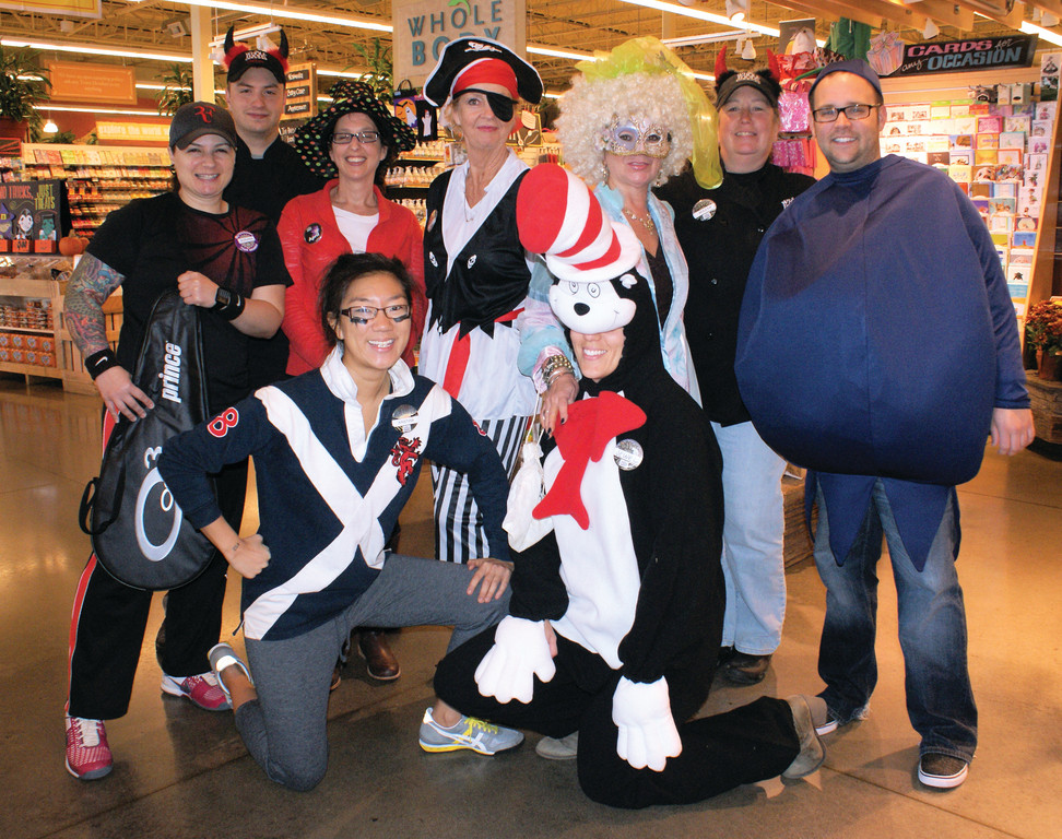 HAUNTED WHOLE FOODS: Getting into the spirit of Halloween are employees at Whole Foods in Cranston. Joining in the fun are Adriana Minacapilli, Ryan Waskewicz, April O'Malley, Chrissy Angell, Patie Griffin, Holly Dion and Michael Plourde. Kneeling are Kristina McDonald and Chelsey Barton.