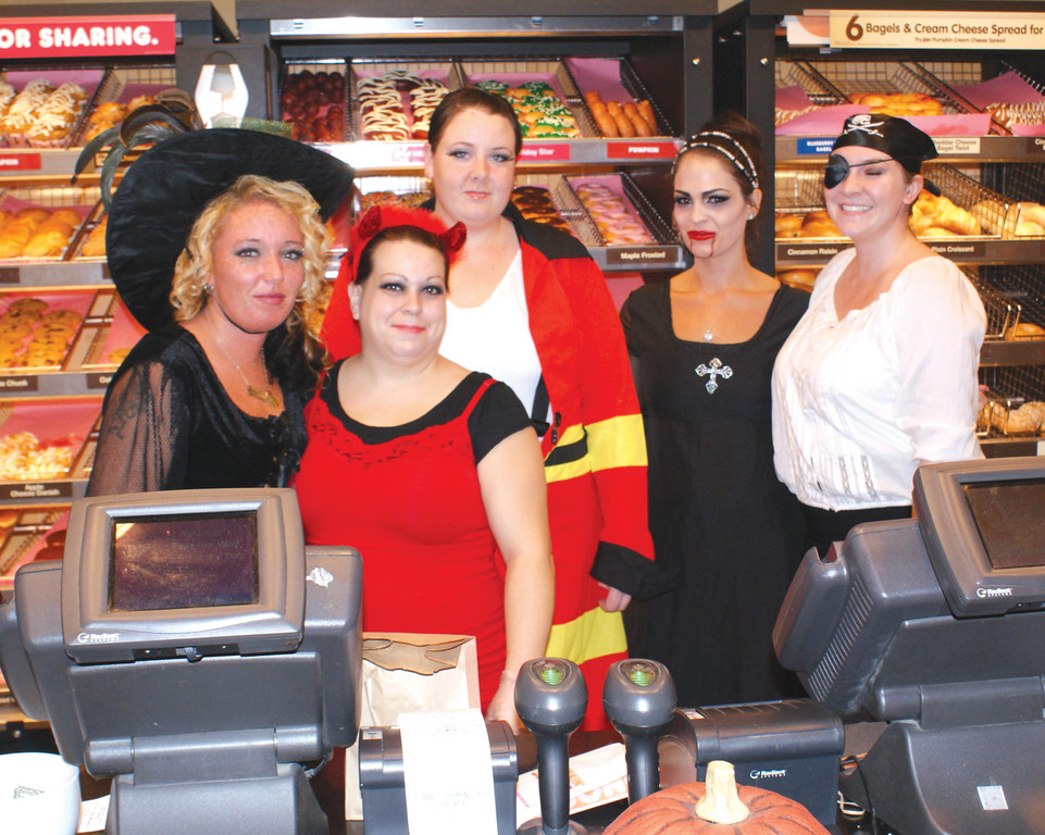 DUNKIN DEVILS: Greeting customers on Halloween night are Amanda Fritsche, Jessica Oliveira, Morgan Haibon, Kerri Smith and Lauren Moss, employees at the Dunkin Donuts on Sockanosset Cross Road.