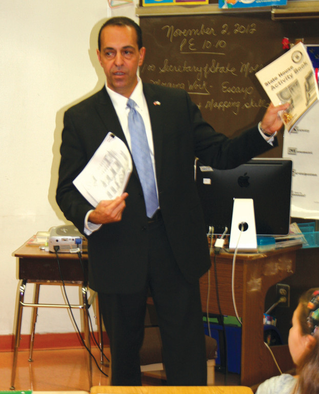 HOW IT WORKS: Secretary of State A. Ralph Mollis visits Oak Lawn Elementary School to speak to students about the electoral process. Here, he shows the students a sample ballot.