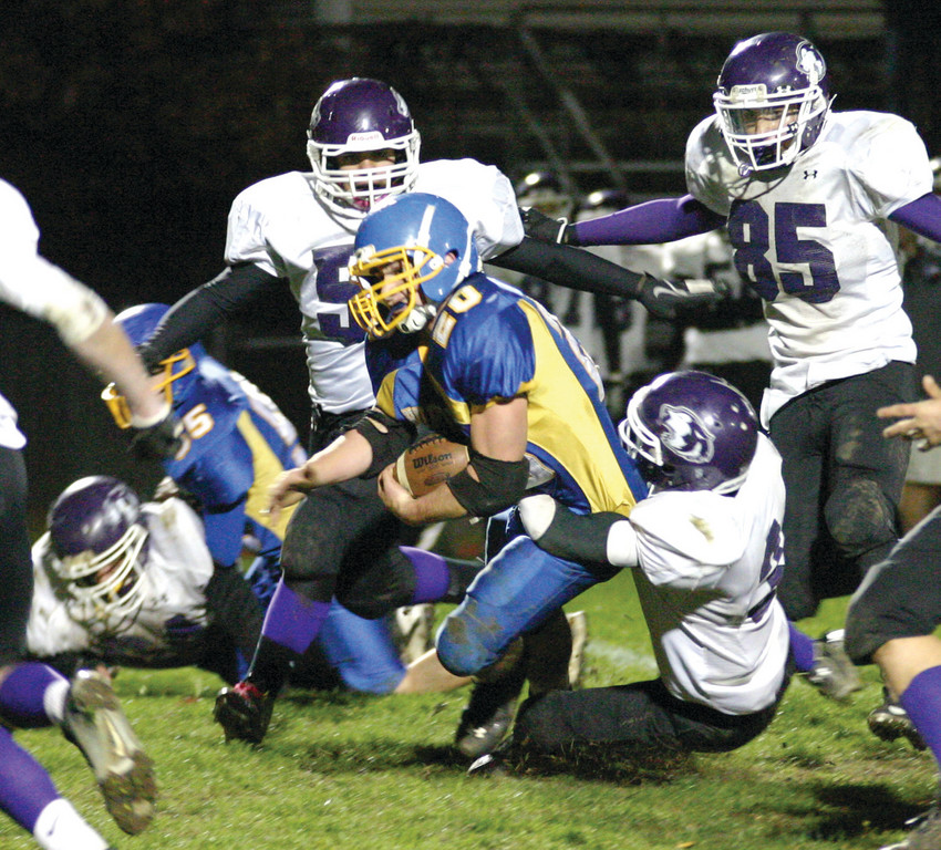 DRAGGED DOWN: Three Mt. Hope defenders converge on Vets' T.J. Boyajian during Friday night's game.
