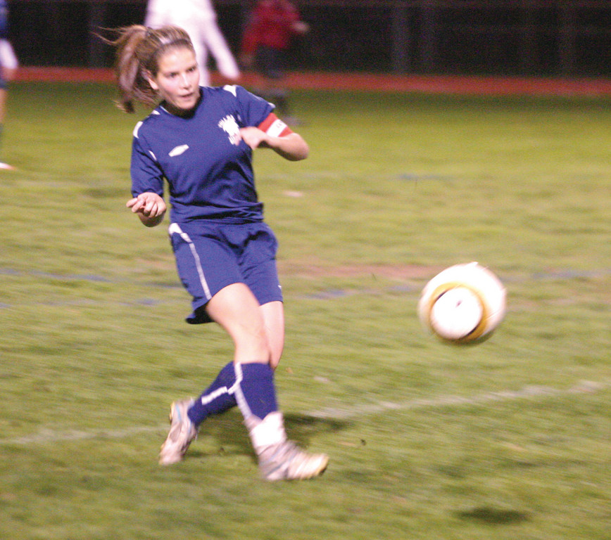ON THE WAY: Toll Gate's Emily Fox sends the ball up the right sideline during Thursday's playoff game with Barrington.