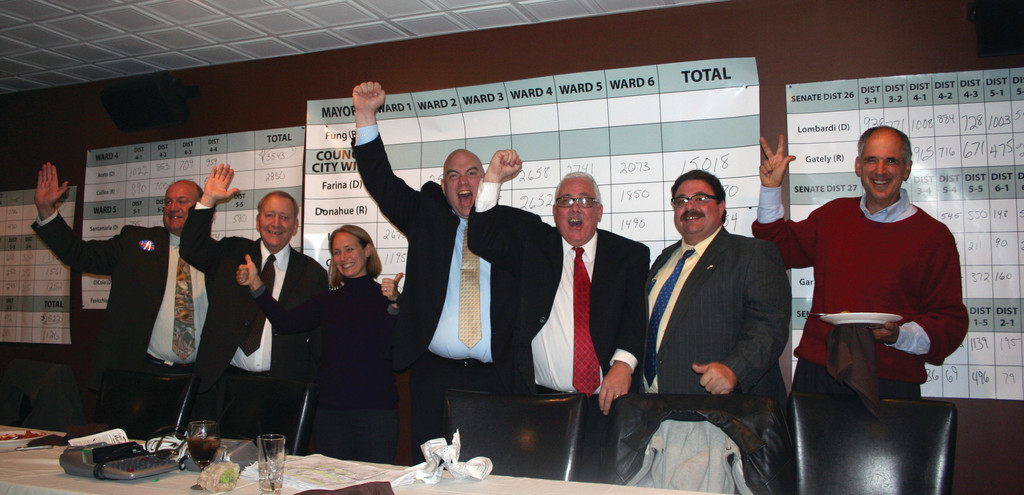 TIME TO PARTY: Celebrating their Democratic victories are Council-elect members Paul Archetto, John Lanni, Sarah Kales Lee, Mike Farina, Richard Santamaria, Mario Aceto and Steve Stycos. The remaining two Council seats went to Republicans Don Botts and Michael Favicchio in Wards 2 and 6.