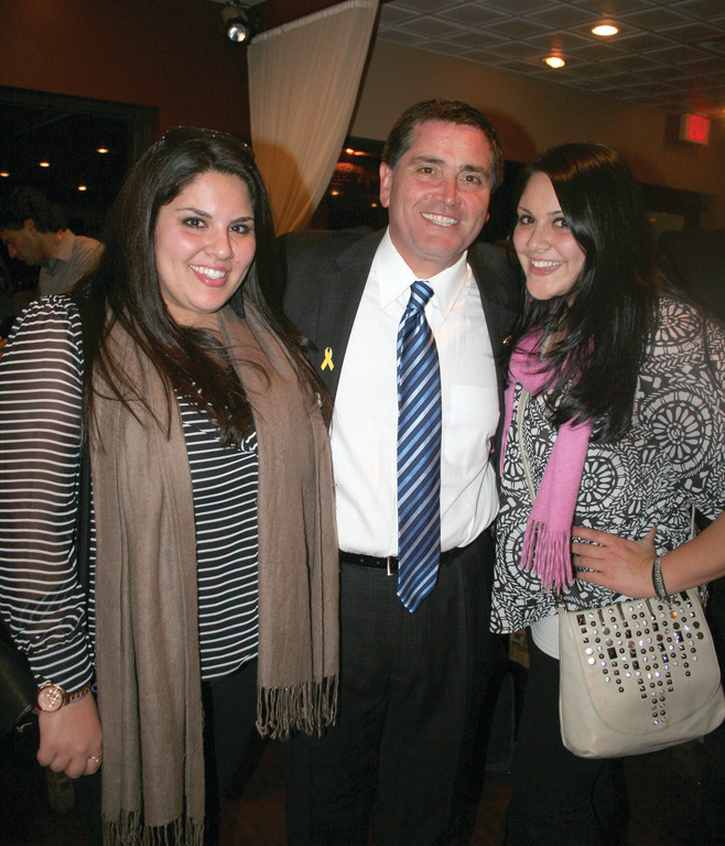 Newly elected Dist. 26 Senator Frank Lombardi with his biggest supporters, twin daughters Cassandra and Christina.