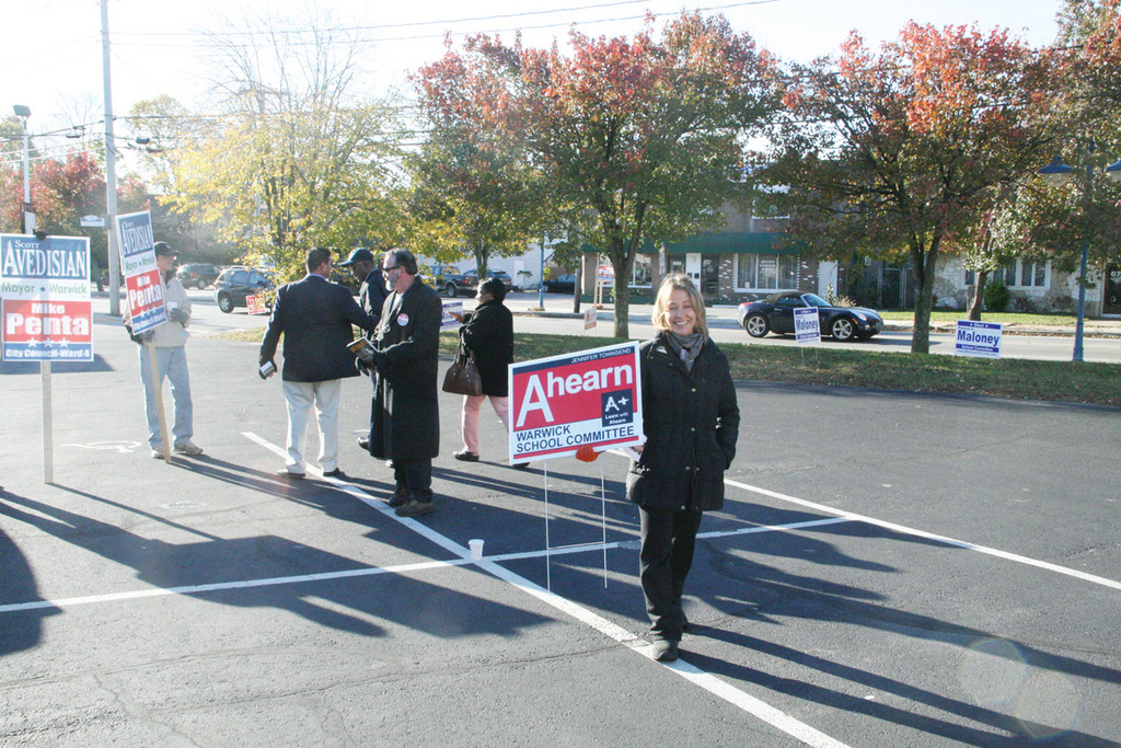 AT THE POLLS: Jennifer Townsend-Ahearn was ready to greet voters as they arrived early Tuesday morning at the Shields Post in Conimicut.