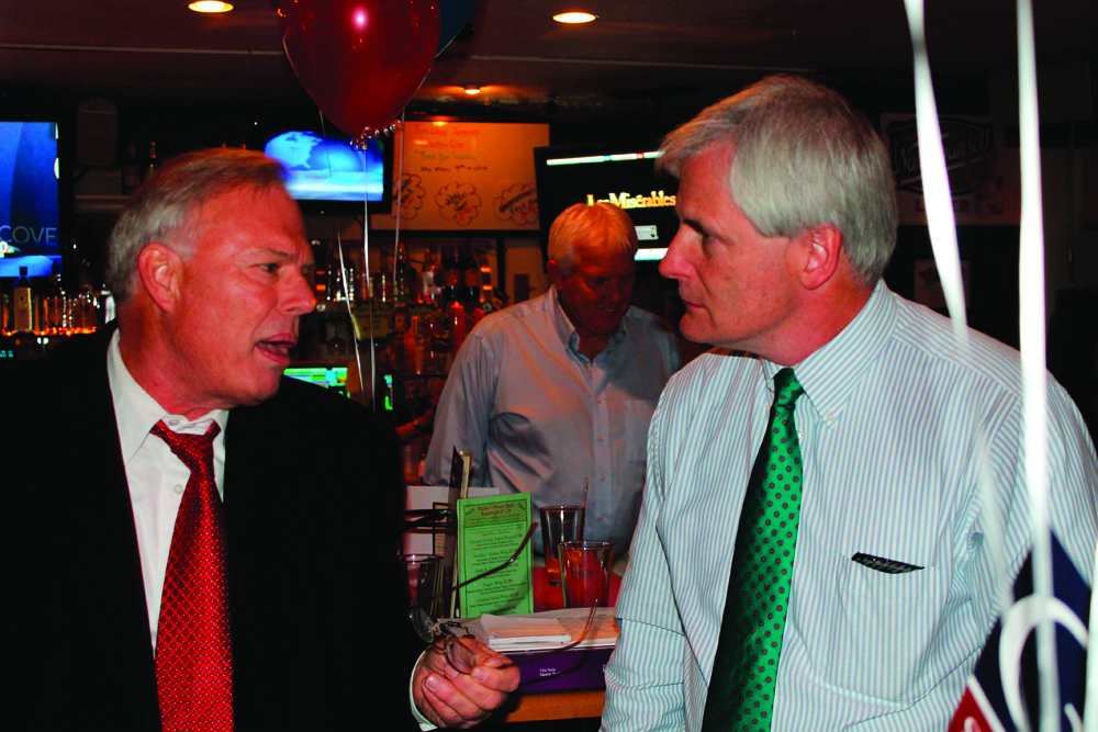 "AMICABLE OPPONENTS: Democratic incumbent Senator Bill Walaska, left, chats with his independent opponent Arthur ""Jack"" Groh at Picasso's Pizza on Tuesday night. Though Walaska was victorious, there was no hostility between the two men, who shared a post-election party venue."