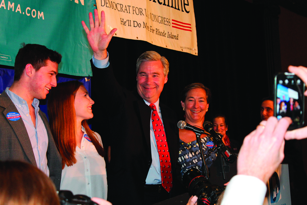 BIG SMILES: Sheldon Whitehouse waves to supporters as he takes the stage at the Providence Biltmore Tuesday night. Whitehouse will retain the Senate seat he has held since 2006.