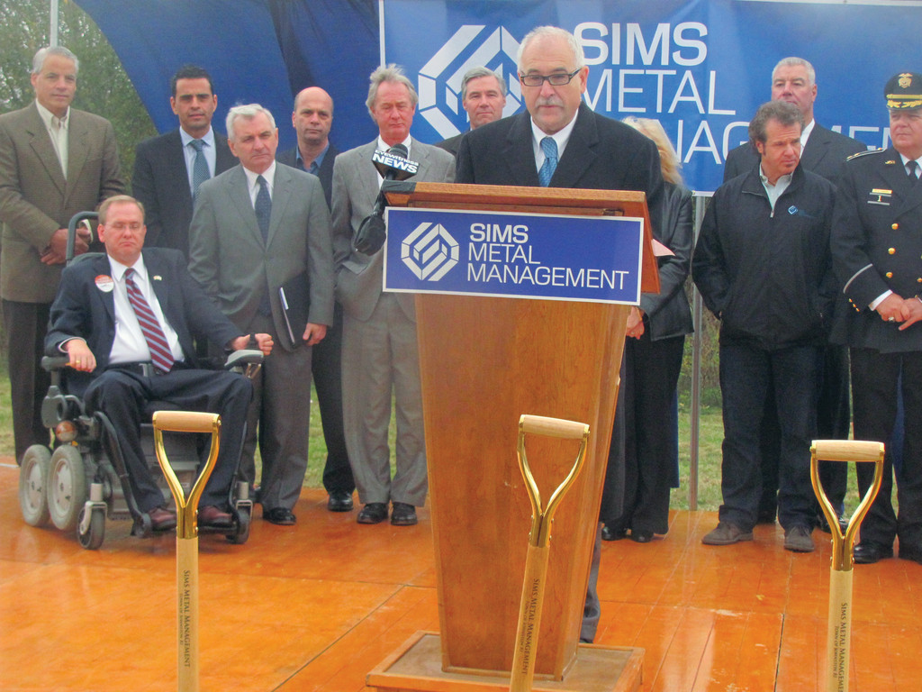 Johnston Mayor Joseph Polisena, who is backed by Rhode Island�s Washington delegation and dignitaries, announces that Sims Metal Recycling Management will build a state-of-the-art $30 million facility on Green Earth Avenue that will mean 100 new jobs in the state.