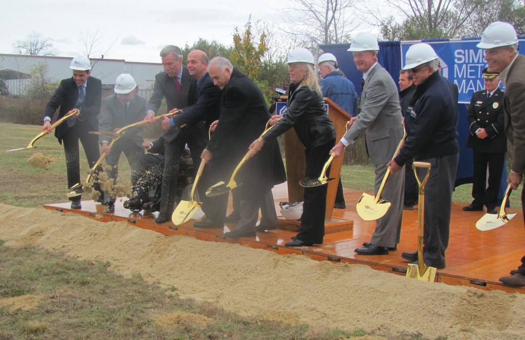 Johnston Town Council President Robert Russo joins Mayor Polisena, Councilman David Santilli and Councilwoman Eileen Fuoco and federal officials in last Friday�s groundbreaking ceremony for the $30 million Sims Metal Recycling Management facility.