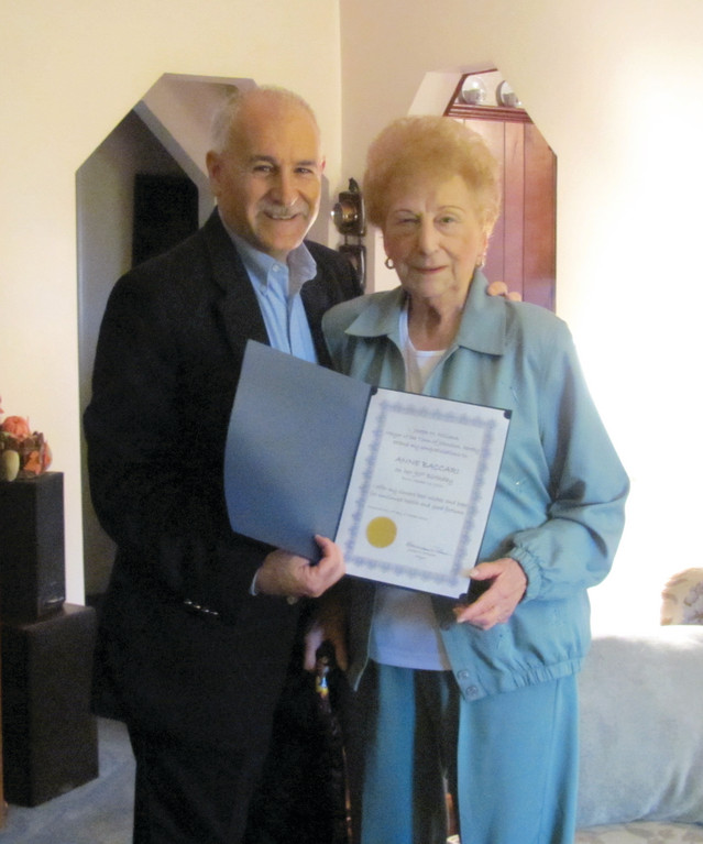 Anne Baccari is all smiles after receiving a proclamation from Mayor Joseph Polisena in honor of her 90th birthday.