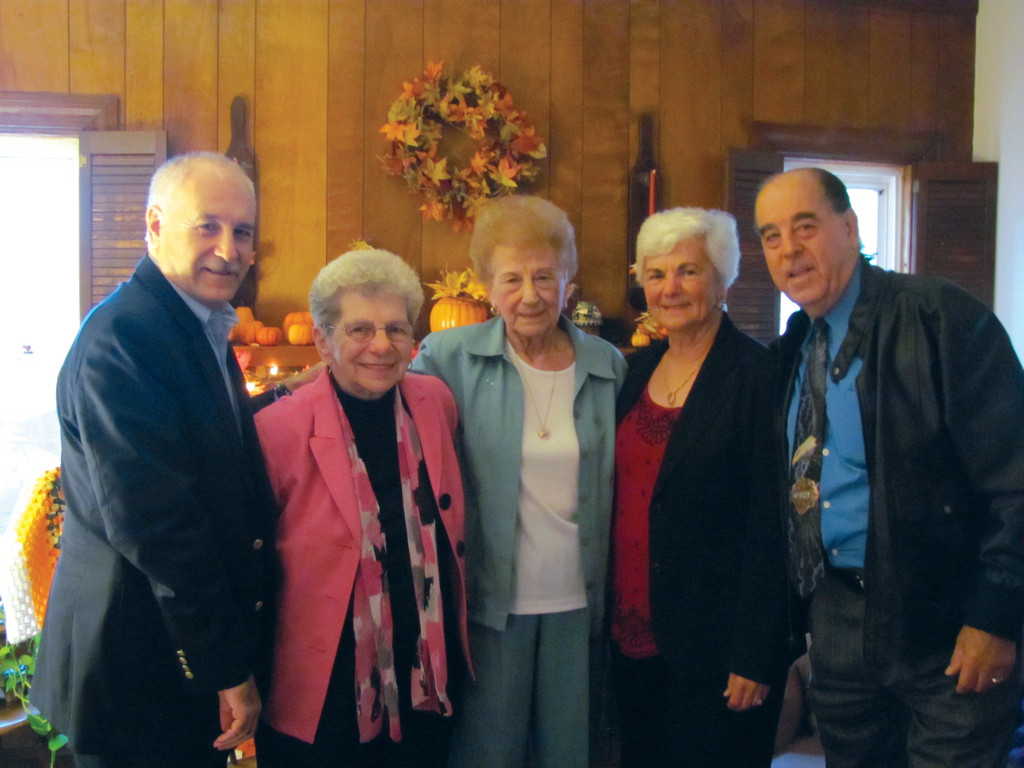 Mayor Joseph Polisena recently paid a visit to Anne Baccari's home to honor the former Johnston Senior Center board chairman on her 90th birthday. She is joined by her friends Claire Mathieu, Theresa Turner and Emo Sabitoni, who took part in the ceremony.